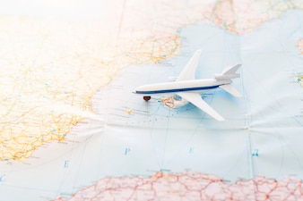 Travel background with toy plane on map