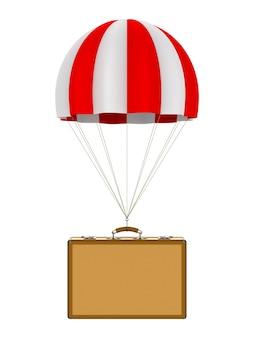 空白のトラベルバッグとパラシュート