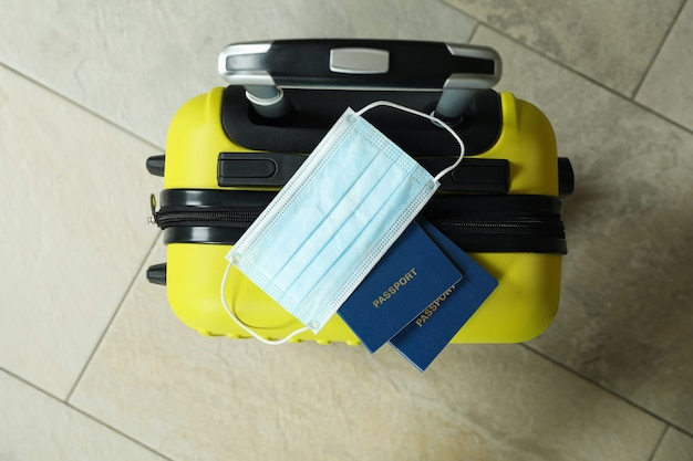 Travel bag with passports and medical mask