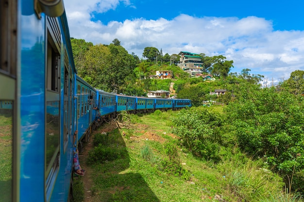 Travel by public train around the island of sri lanka. the train travels through mountains and tea plantations. scenic railway.