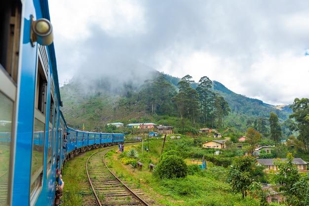 Travel by public train around the island of sri lanka. the train travels through mountains and tea plantations. scenic railway