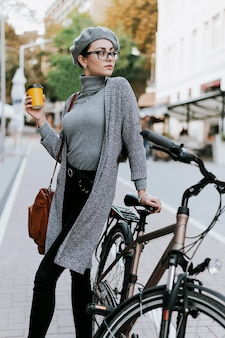 Travel in the city life with bicycle and drinking coffee