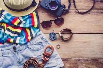 Travel Clothing accessories Apparel along on wooden floor