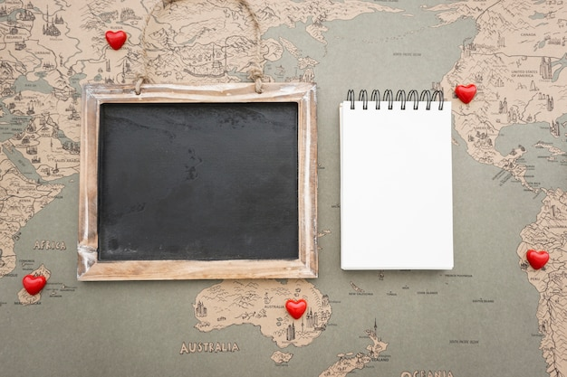 Travel composition with slate and notebook for messages