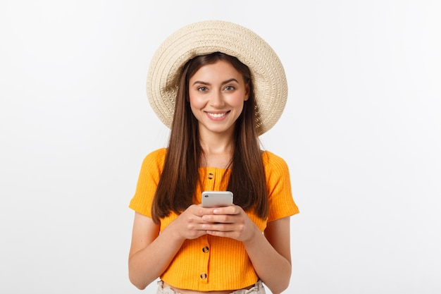 Travel concept - close up portrait young beautiful attractive girl wtih trendy hat and smiling.