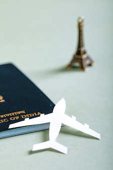 Travel concept, indian passport with paper airplane