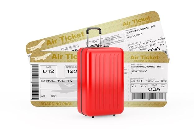 旅行のコンセプト。白い背景の上の2つのゴールデンビジネスまたはファーストクラスの航空会社の搭乗券フライエアチケットの前にある大きな赤いポリカーボネートのスーツケース。 3dレンダリング