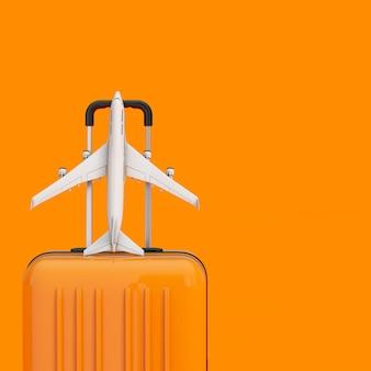 Концепция путешествия. оранжевый чемодан путешествия с белой моделью самолета пассажиров реактивного самолета на оранжевой предпосылке. 3d рендеринг