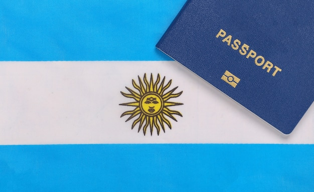 Travel concept. passport against the background of argentina flag