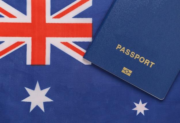 Travel concept. passport against the background of australia flag