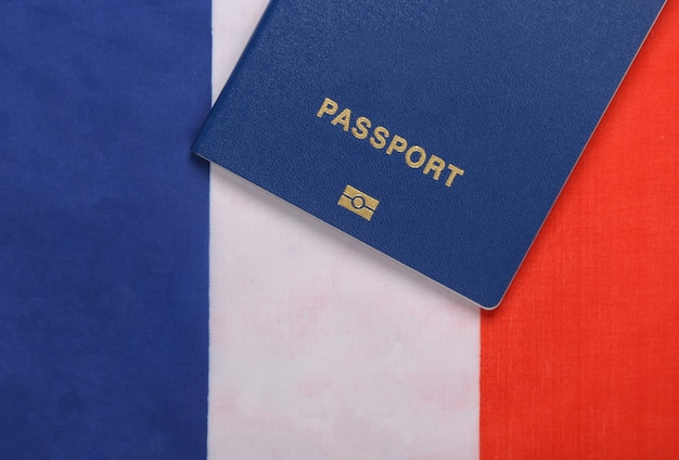 Travel concept. passport against the background of the france flag