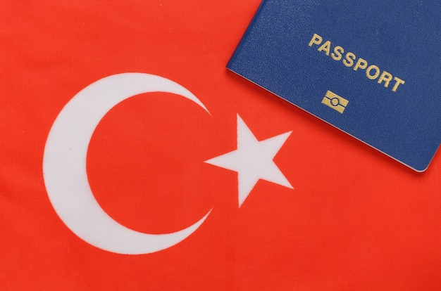 Travel concept. passport against the background of turkish flag