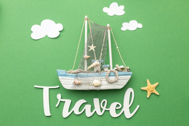 Travel concept with boat and clouds