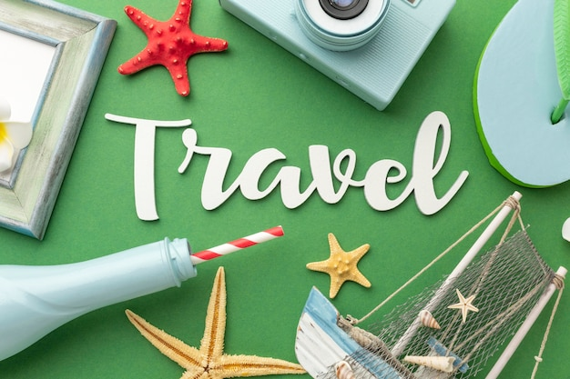 Travel concept with items on green background