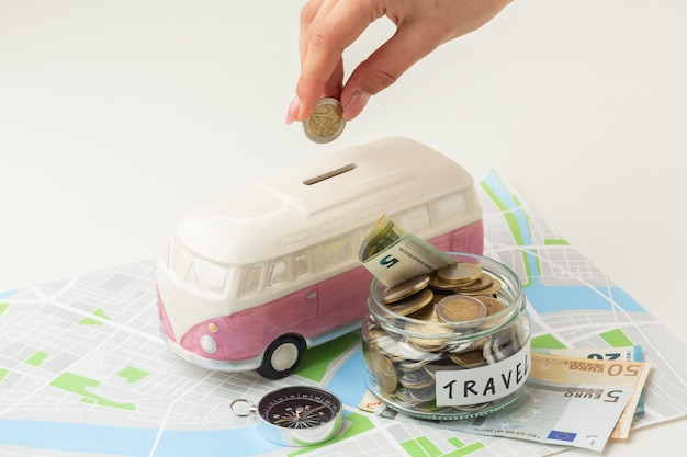 Travel concept with money jar high angle