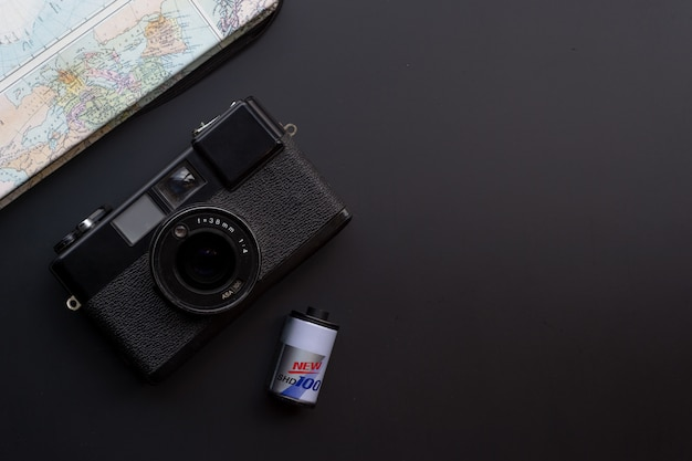 Travel concept. with old camera films, map, book and travel accessories