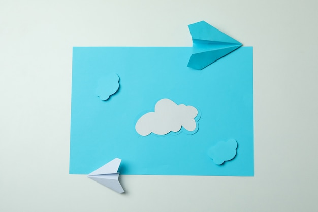 Travel concept with paper planes and clouds
