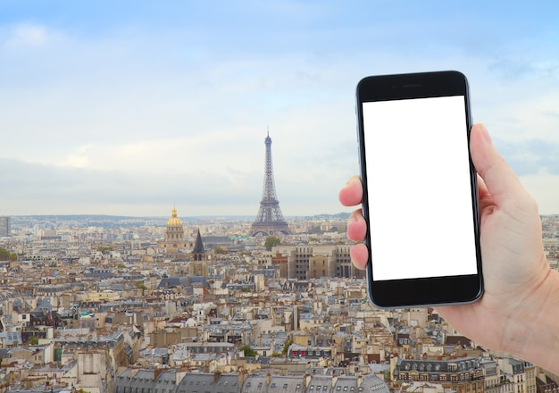 Travel concept with  skyline of paris city with eiffel tower from above, france, copy space for advetizement on smartphone screen