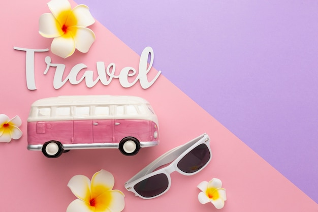 Travel concept with sunglasses and flowers