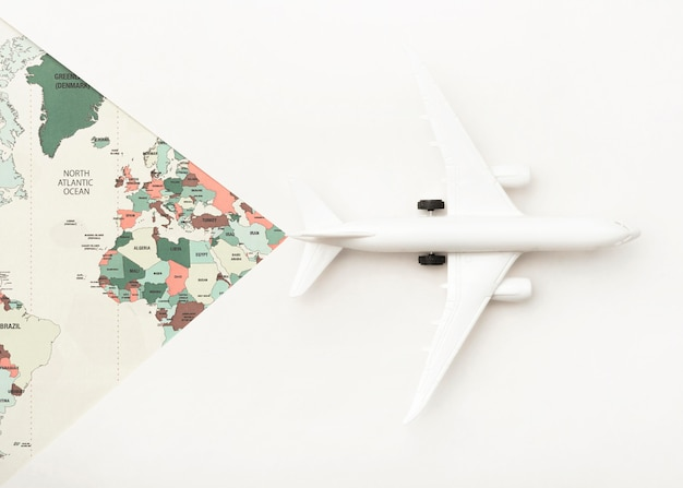 Travel concept with world map and toy plane