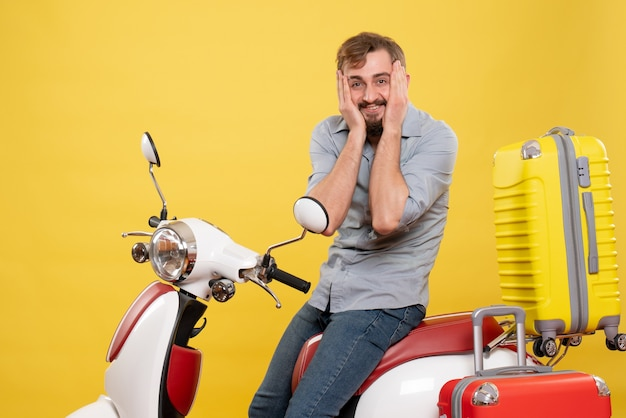 Travel concept with young tired emotional bearded man sitting on motocycle on it on yellow