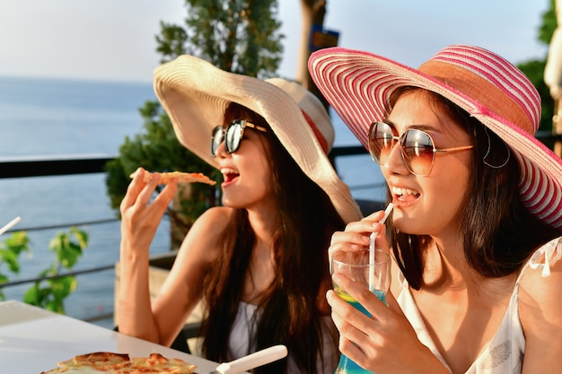 Travel concepts. beautiful girl is eating at a seaside restaurant.
