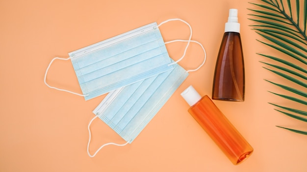 Travel during the coronavirus. tanning creams, palm leaves and medical masks.