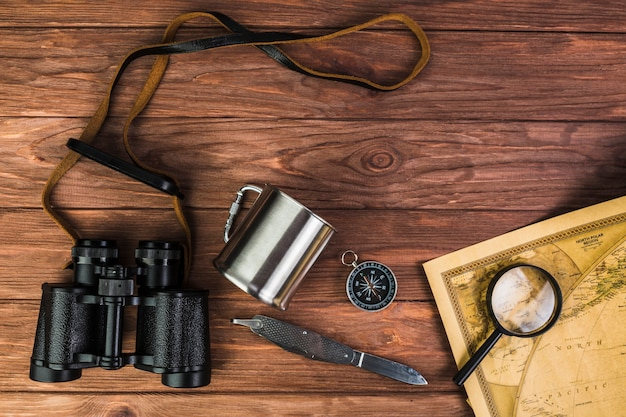 Travel equipment items on wooden table