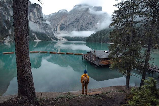 Travel hiker at lake braies in the dolomites mountains, italy. hiking trip and adventure.