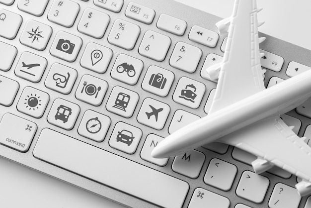 Travel icon on computer keyboard for online booking concept