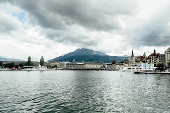 Travel in Switzerland. Beautiful view on lake in Lucerne, city and mountain. Tourism