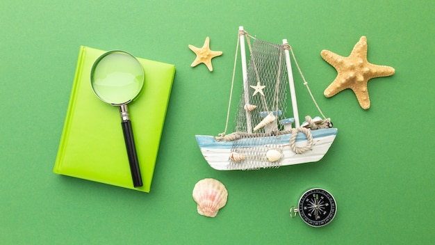 Travel items on green background top view
