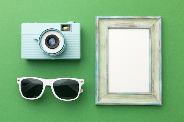 Travel items on green background above view