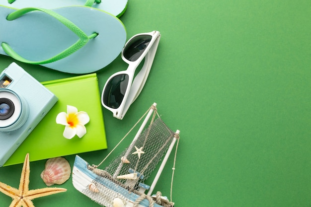 Travel items on green background