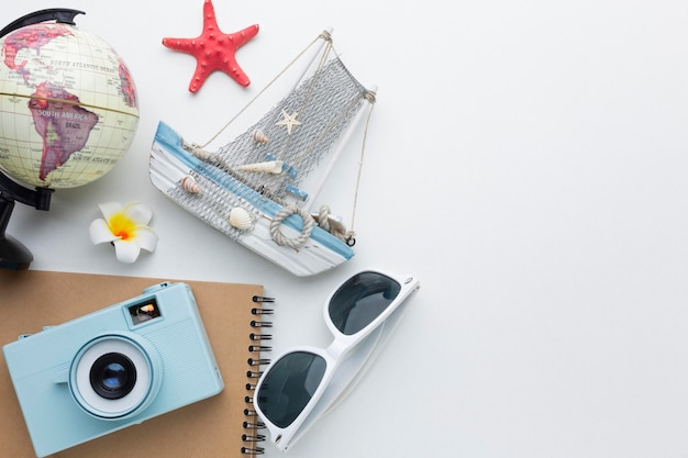 Travel items on white background above view