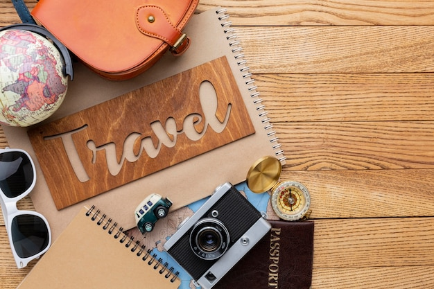 Travel items on wooden background Free Photo