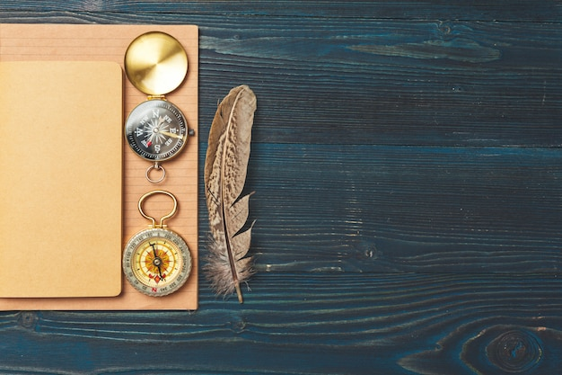 Travel items on wooden table.