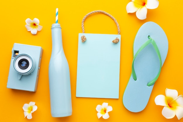 Travel items on yellow background