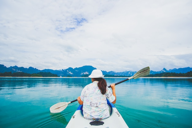 Travel kayaking and canoeing with women. view mountain