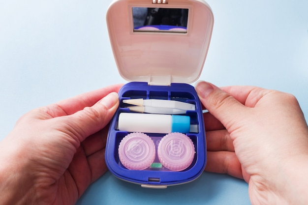 Travel kit for contact lenses, tweezers and containers for moisturizing solution and drops