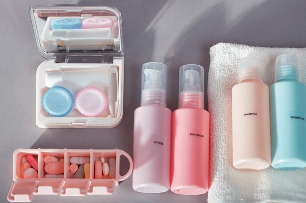 Travel kit. set of  bottles for cosmetic products, kit for contact lenses, pill organizer, towel.
