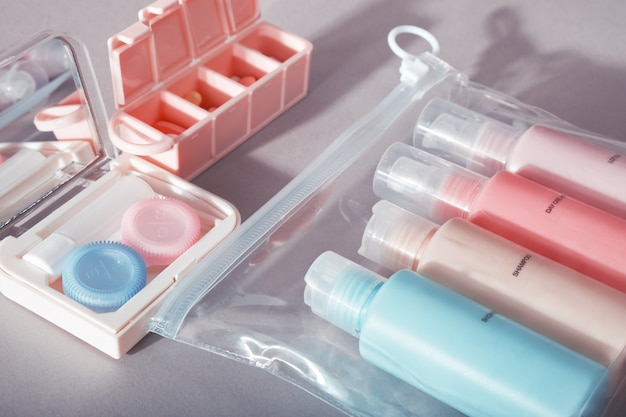 Travel kit. set of small bottles for cosmetic products, kit for contact lenses, pill organizer.