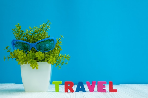 Travel letters text and notebook paper and little decoration tree