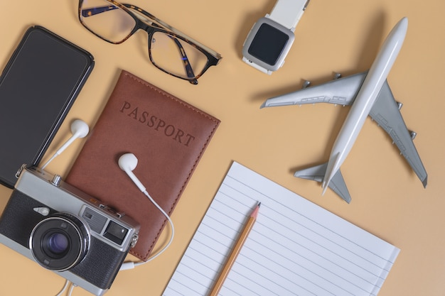 Travel objects and accessories on yellow, hi tech gadgets for vacation travel and blogger