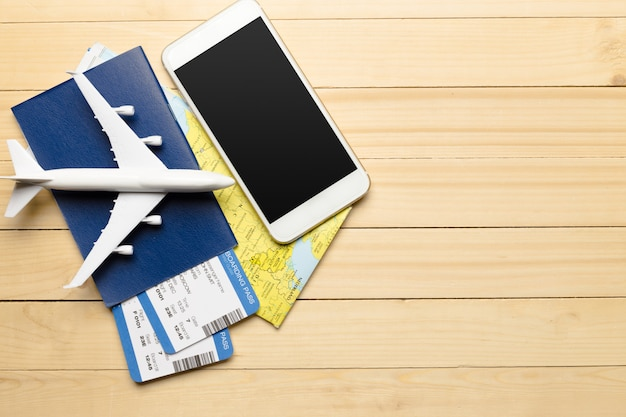 Travel objects on wooden surface