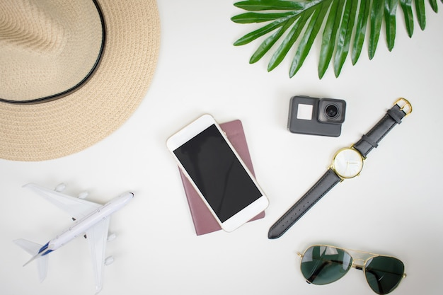 Travel plan with tourist accessories on a white background