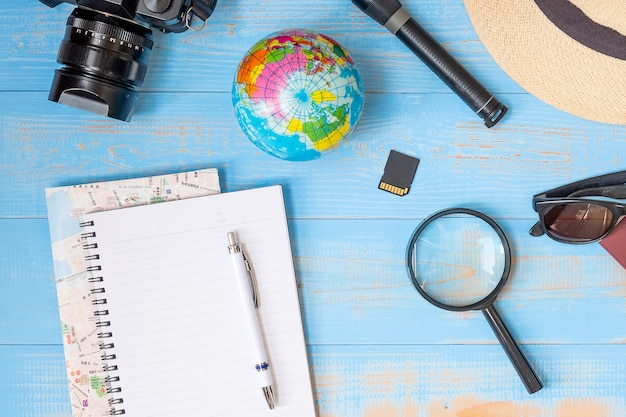 Travel planning concept background. traveler's accessories