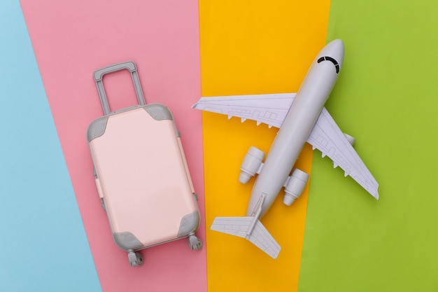 Travel planning. mini toy travel luggage and air plane