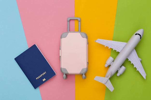 Travel planning. mini toy travel luggage, passport and air plane