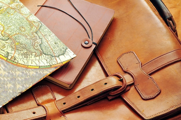 Travel planning note map leahter briefcase on wooden background